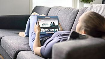 woman watching movie on tablet