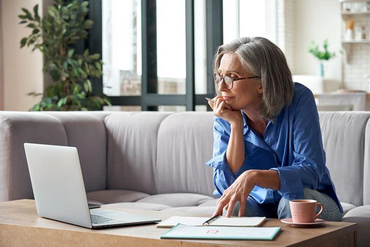 woman using laptop online